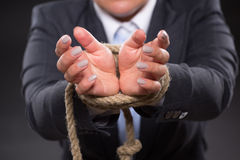 Tied up hands with rope Stock Photo