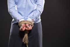 Tied up hands with rope Stock Photos