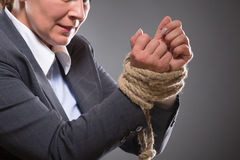 Tied up hands with rope Stock Photography