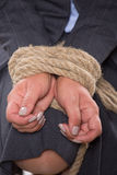 Tied up hands with rope Royalty Free Stock Photos