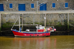 Tied up in Harbour. Fishing Boat tied up in Harbour at low tide Royalty Free Stock Photo