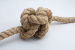 Tied up rope knot isolated on a white background Stock Photo