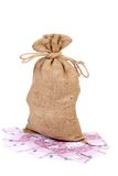 Tied up sack standing on five hundred euro. Royalty Free Stock Images
