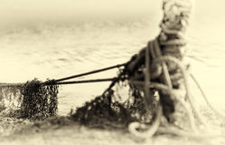 Tied up ship rope on Norway beach in sepia Royalty Free Stock Images