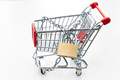 Tied up trolley with padlock. Stock Photo