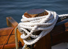 Tied white rope Stock Images