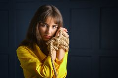 Free Tied With Rope Young Woman Tied Hands Woman In Captivity Royalty Free Stock Image - 145108196