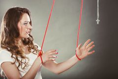Tied woman forced to pray. Fake faith. Religion. Royalty Free Stock Photography