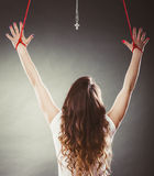 Tied woman forced to worship. Fake faith religion. Royalty Free Stock Photos