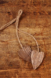 Tied wooned hearts on old  wood Stock Photos