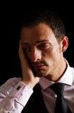Tief deprimierter Geschäftsmann Lizenzfreies Stockbild