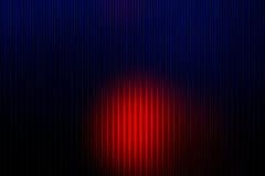 Tiefe blaue und rote Zusammenfassung mit hellen Linien verwischte Hintergrund Stockfotografie