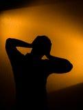 Tiefstand und Schmerz - Schattenbild des Mannes Stockbilder