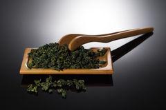 Tieh-Kuan-Yin Tieguanyin Tea. Tieh-Kuan-Yin(Tieh Kuan Yin, Tieguanyin, Tie Guan Yin) Dry Tea Leaves.Herbal Tea Stock Images