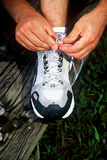 Tieing Shoe. Man tieing athletic shoe Stock Images