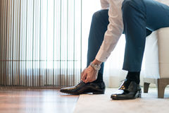 Tieing Shoe. The groom bent over to tie his shoe Stock Images