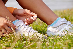 Tieing shoe-laces in nature outdoors Stock Image