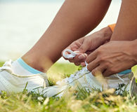 Tieing shoe-laces in nature Stock Photo