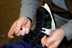 Tieing the skates Royalty Free Stock Photography