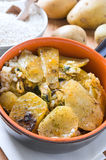 Tiella of potatoes, rice and mussels. Royalty Free Stock Photo