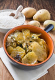 Tiella of potatoes, rice and mussels. Stock Image