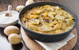 Tiella of potatoes, rice and mussels. Royalty Free Stock Images