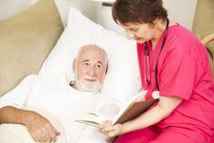 Tiempo casero de la historia del Caregiver- Imágenes de archivo libres de regalías