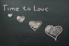 Tiempo de la inscripción para amar Foto de archivo