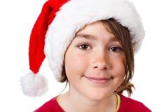Tiempo de la Navidad - muchacha con el sombrero de Santa Claus Foto de archivo libre de regalías