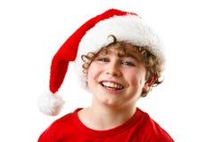 Tiempo de la Navidad - muchacho con Santa Claus Hat Fotos de archivo libres de regalías