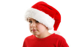 Tiempo de la Navidad - muchacho con Santa Claus Hat Foto de archivo libre de regalías