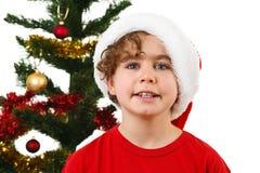 Tiempo de la Navidad - muchacho con Santa Claus Hat Imágenes de archivo libres de regalías