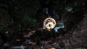Tiempo de la piedra del agua del fuego Foto de archivo libre de regalías