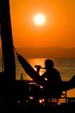 Tiempo de relajación en la puesta del sol Fotografía de archivo libre de regalías
