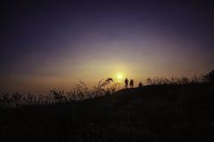 Tiempo del fotógrafo y de la puesta del sol Foto de archivo libre de regalías