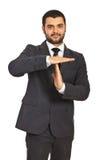 Tiempo del gesto del hombre de negocios hacia fuera Foto de archivo