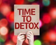 Tiempo a la tarjeta del Detox con el fondo colorido con las luces defocused Foto de archivo