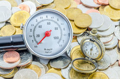 Tiempo pasado en la fabricación del dinero Imagenes de archivo