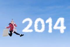 Tiempo que hace compras del Año Nuevo 2014 Foto de archivo