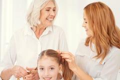 Tiempo radiante de la familia del gasto de la abuelita con su hija y nieto Fotos de archivo libres de regalías