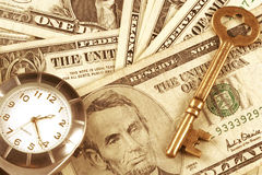 Tiempo y dinero Foto de archivo libre de regalías