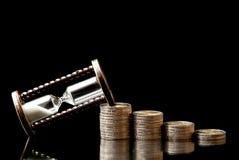 Tiempo y dinero imagen de archivo libre de regalías