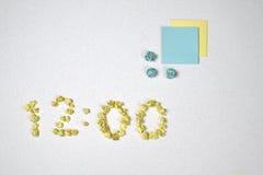 Tiempo y dos etiquetas engomadas Imágenes de archivo libres de regalías