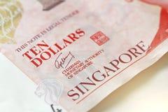Tien Dollars van Singapore met Één Nota 10 dollars Stock Afbeelding