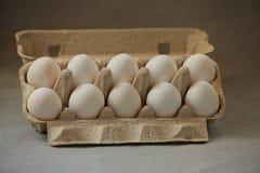 Tien eieren in een doos Royalty-vrije Stock Afbeeldingen