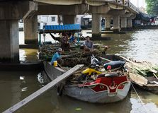 Tien Giang, Vietnam - Nov 28, 2014: Floating boat loaded with sugar cane on sale at Cai Be floating market, one of the busiest mar royalty free stock images