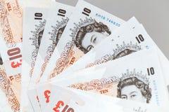 Tien pond neemt nota van bundel van de Bank van Engeland Stock Foto