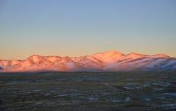 Tien Shan berg på solnedgången Fotografering för Bildbyråer