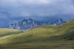 Tien Shan mountain range in Kyrgyzstan before storm. Tien Shan mountains, view at mountain range, before storm, Kyrgyzstan, Asia royalty free stock photo