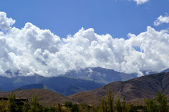 Tien Shan mountains and clouds. Terskey Ala-Too mountains in summer Stock Photos